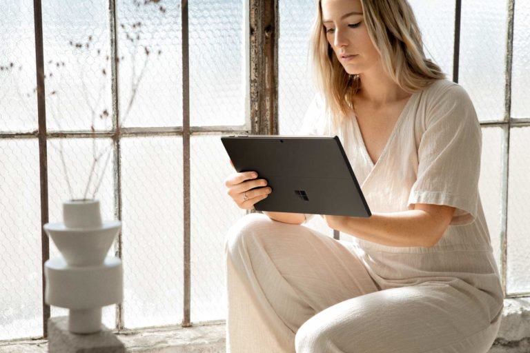 Woman uses Surface Pro